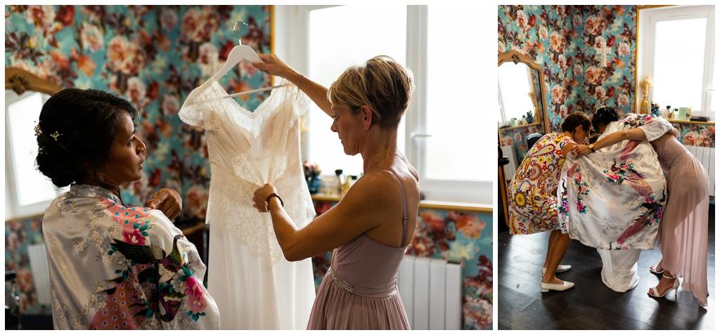 enfilage de la robe de mariée elsa gary au salon joakim coiffeur barbier près de caen